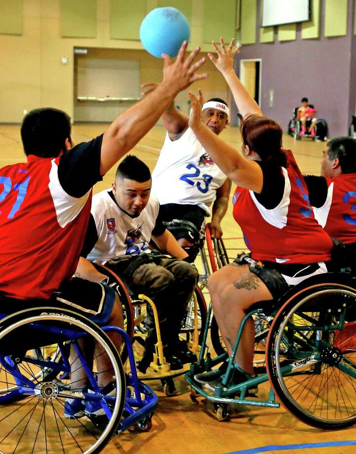 Nakia Merritte,23, playing for STRAPS-Hawks tries to score on STRAPS-Stars during an intramural game for South Texas Regional Adaptive & Paraylympis Sports (STRAPS)  at Morgan Wonderland Events Center on Sunday, October 2, 2016. Photo: Ron Cortes, Freelance / For The San Antonio Express-News