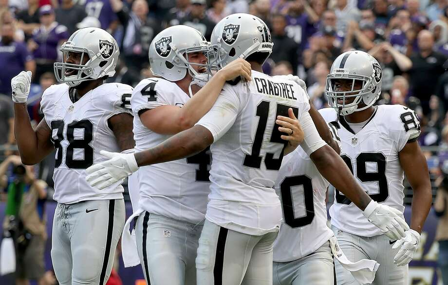 Derek Carr and Michael Crabtree of the Oakland Raiders celebrate after scoring a touchdown in the fourth quarter against the Baltimore Ravens at M&T Bank Stadium on October 2, 2016 in Baltimore, Maryland.  (Photo by Rob Carr/Getty Images) Photo: Rob Carr, Getty Images
