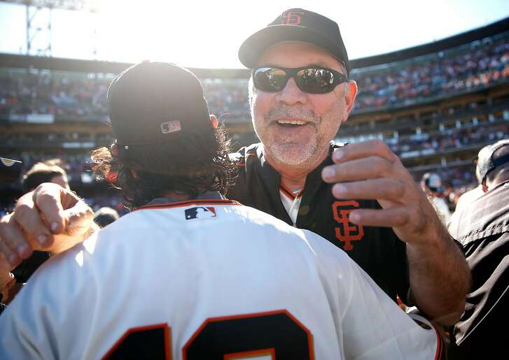 San Francisco Giants' manager Bruce Bochy celebrates with Angel Pagan after the Giants clinched a wild card berth with 7-1 win over Los Angeles Dodgers during MLB game at AT&T Park in San Francisco, Calif., on Sunday, October 2, 2016.