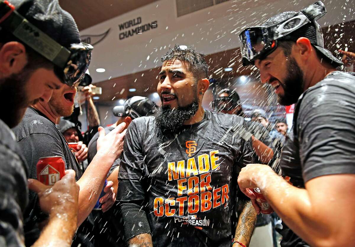 San Francisco Giants' Sergio Romo celebrates after the Giants clinched a wild card berth with 7-1 win over Los Angeles Dodgers during MLB game at AT&T Park in San Francisco, Calif., on Sunday, October 2, 2016.