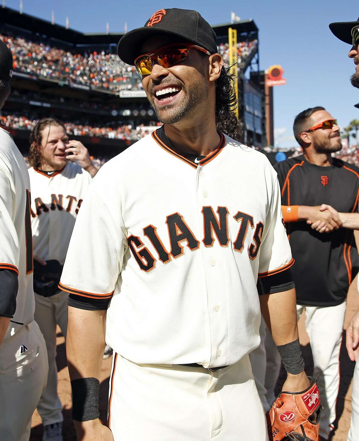 San Francisco Giants' Angel Pagan celebrates after the Giants clinched a wild card berth with 7-1 win over Los Angeles Dodgers during MLB game at AT&T Park in San Francisco, Calif., on Sunday, October 2, 2016.