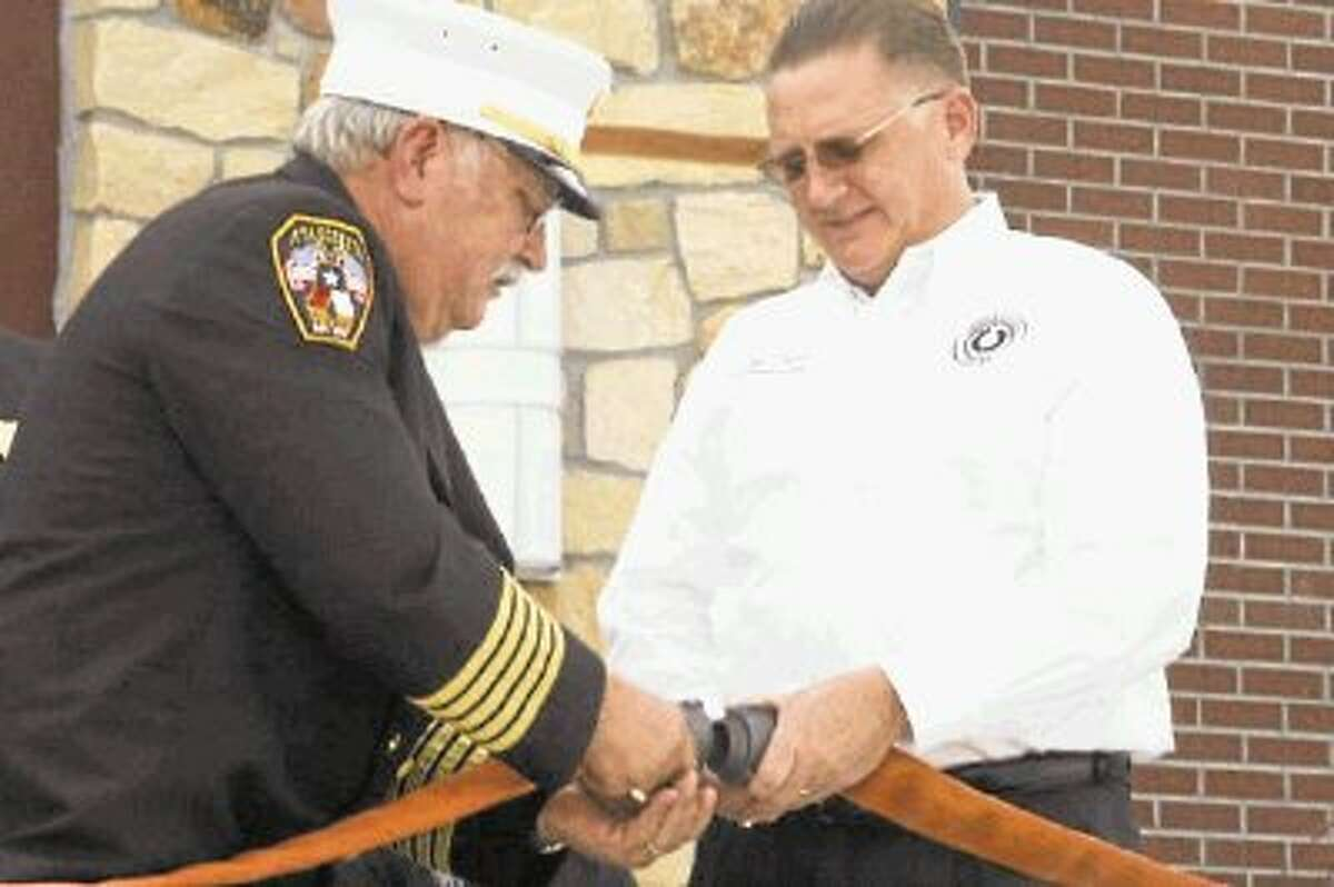 To celebrate the dedication, both AVFD Chief Bill Bivens and Tom Truver participated in a hose uncoupling ceremony to mark the official opening of the new Atascocita Volunteer Fire Department's Neal W. Smith Training Facility July 27, 2013.