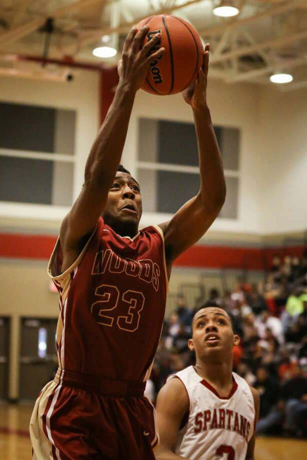 Cy Woods guard Josh Samuels goes for a layupagainst Cy Lakes on Friday at Cy Lakes High School. Cy Woods won, 76-73. To view or purchase this photo and others like it, go to HCNPics.com. Photo: Michael Minasi