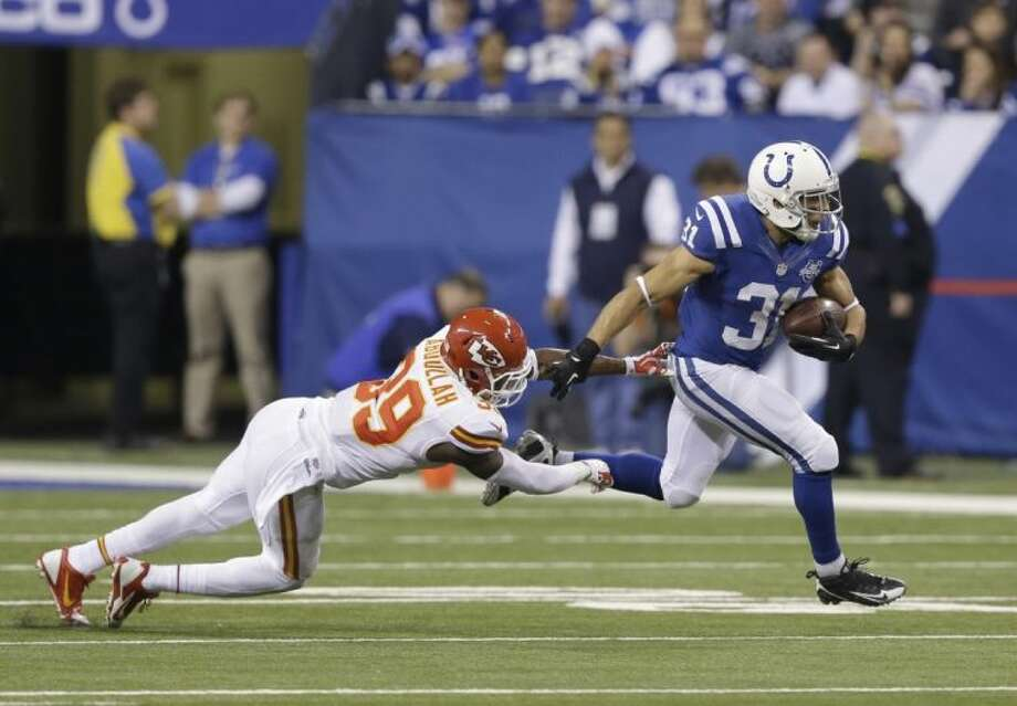 Indianapolis Colts running back Donald Brown (31) gets past a Chiefs defender during the second half. The Colts won 45-44.