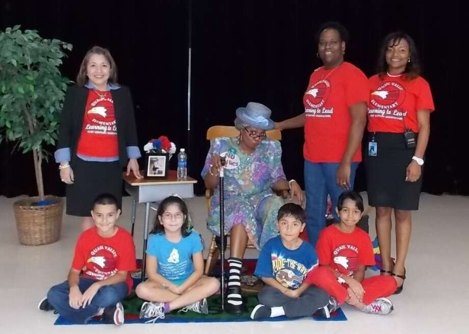 "Pictured (front row, from left) are students Gabriel Vasquez, Sara Dean, Vincente Dean and Jackie Athaide; and (back row) Lulu DeAnda, principal; Seeju Dupre, as ""Granny Dupre"", Lisa Jones, counselor; and Shenique Spears, assistant principal. Photo: Courtesy FBISD"