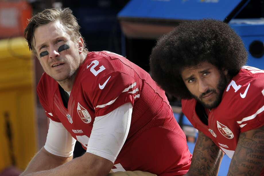 Blaine Gabbert (2) and Colin Kaepernick (7) on the bench during a Cowboys possession in the first half as the San Francisco 49ers played the Dallas Cowboys at Levi's Stadium in Santa Clara, Calif., on Sunday, October 2, 2016. Photo: Carlos Avila Gonzalez, The Chronicle