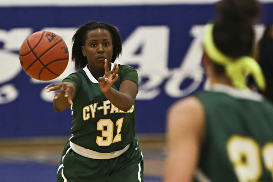 Kiara McElroy and Cy Falls moved to 3-1 in district play Friday.  Photo: Michael Minasi