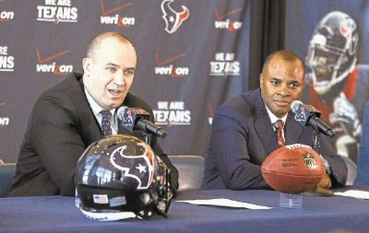 New Houston Texans head coach Bill O'Brien addresses the media with General Manager Rick Smith at Reliant Stadium on Friday.