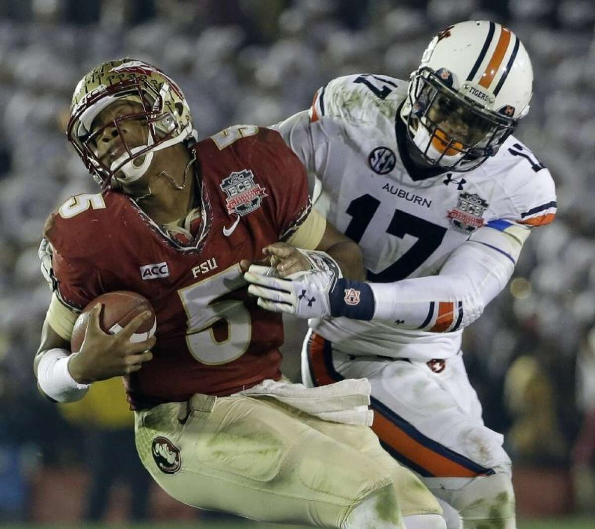Auburn's Kris Frost tackles Florida State's Jameis Winston on a run during the second half of the NCAA BCS National Championship game. Florida State won 34-31.