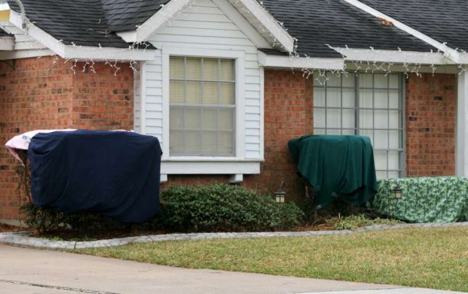 Homeowners gathered blankets and sheets to protect their outdoor greenery.