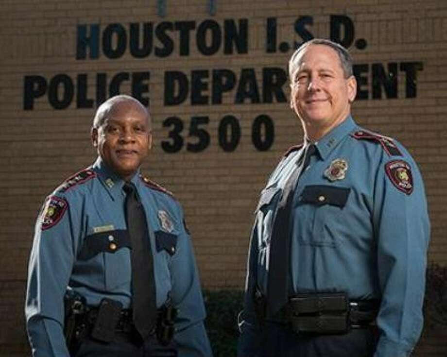 Houston ISD Chief of Police Jimmy Dotson, left, with his successor, Assistant Chief Robert Mock.