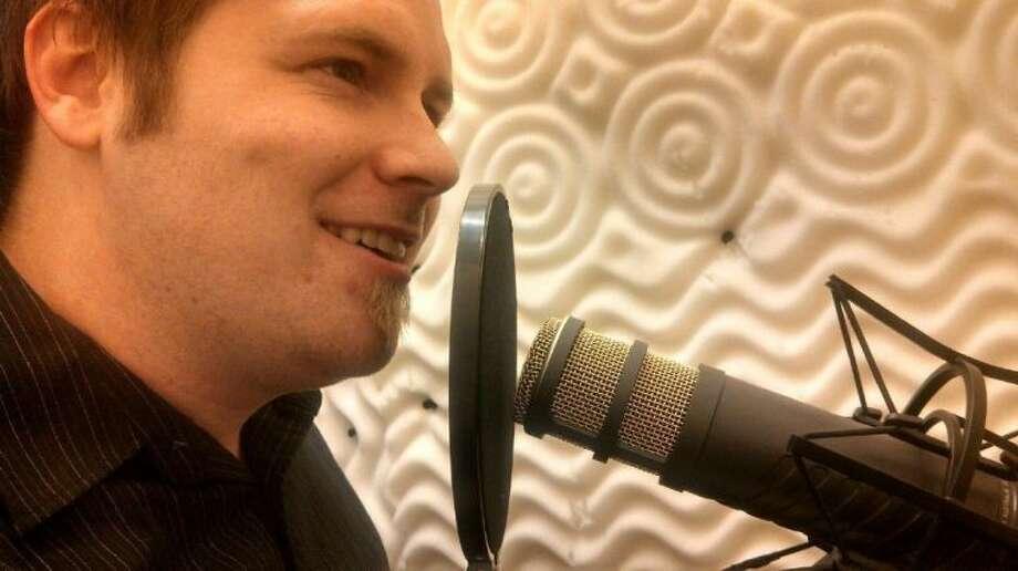 Chris Harp of Tarkington records the voice part of an audiobook. Photo: JACOB MCADAMS