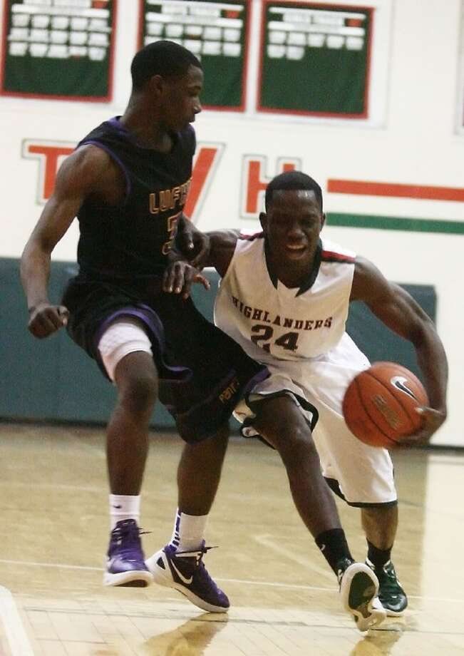 The Woodlands' Timi Adeleye dribbles past a Lufkin player Tuesday at The Woodlands High School.