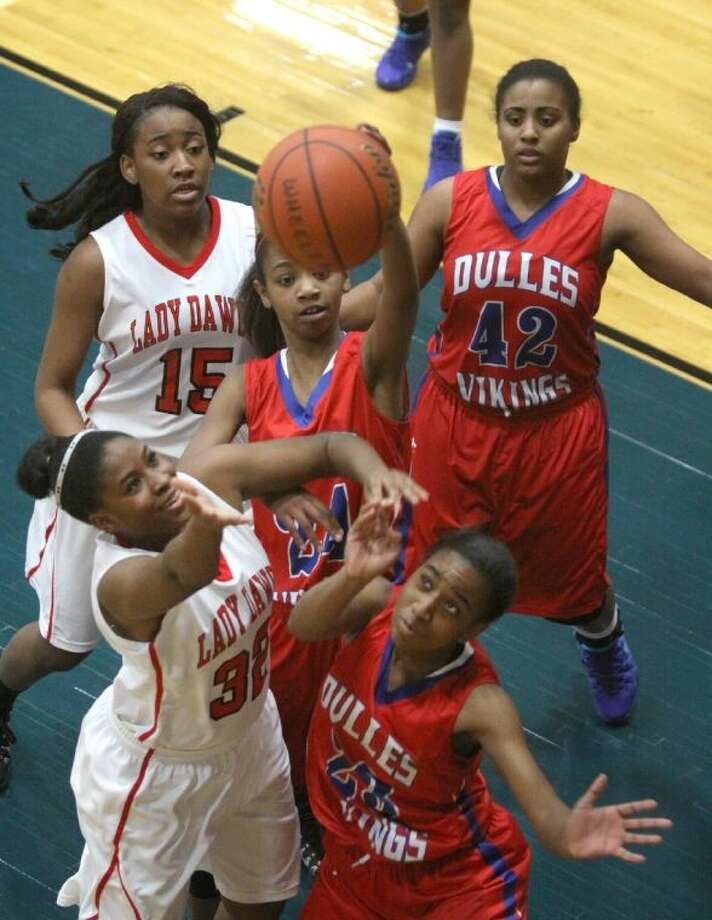 Austin's Nakilah Robinson and Dulles' Taylre Holcombe go for rebound during a Jan. 2 game at Wheeler Fieldhouse in Sugar Land. Visit HCNPics.com for more photos. Photo: Alan Warren