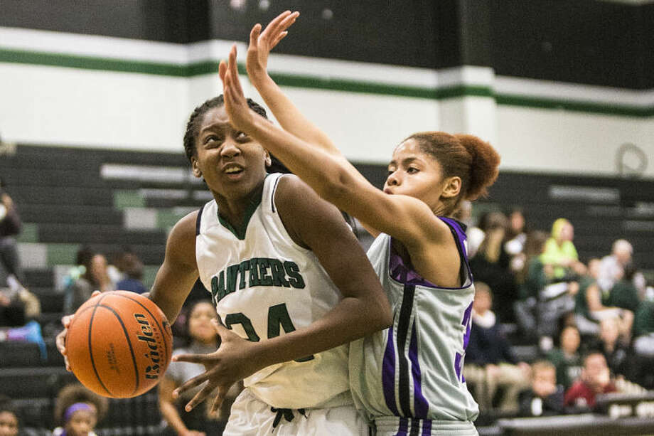 Kingwood Park's Dominique Harrison drives to the basket as Kingwood Park defeats Humble on Jan. 7, 2014, at Kingwood Park High School. (Photo by ANDREW BUCKLEY/The Observer) Photo: ANDREW BUCKLEY