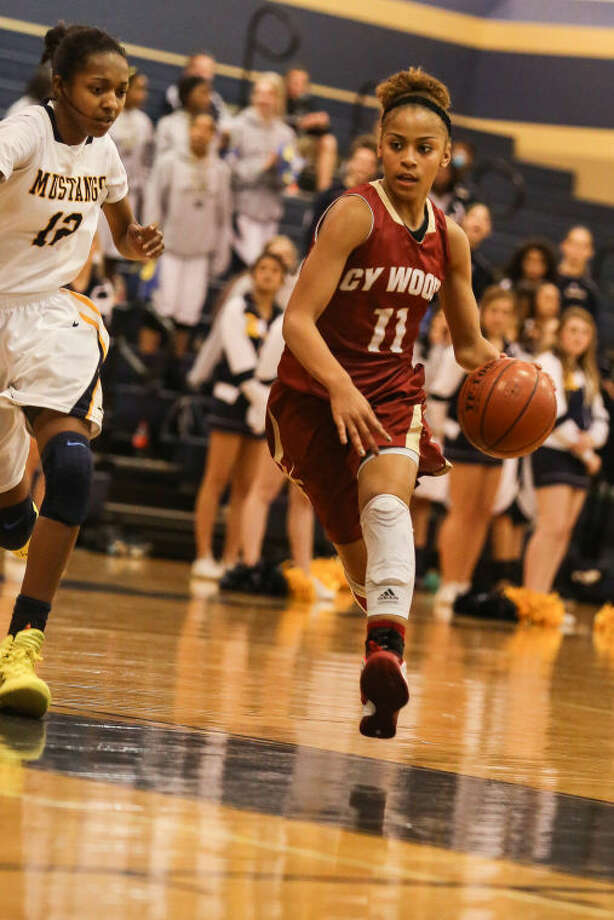 Cy Woods' Tatyana Perez (11) tries to get past Cy Ranch defenders during the two teams' game Tuesday at Cy Ranch High School. To view or purchase this photo and others like it, go to HCNpics.com. (Michael Minasi / HCN)