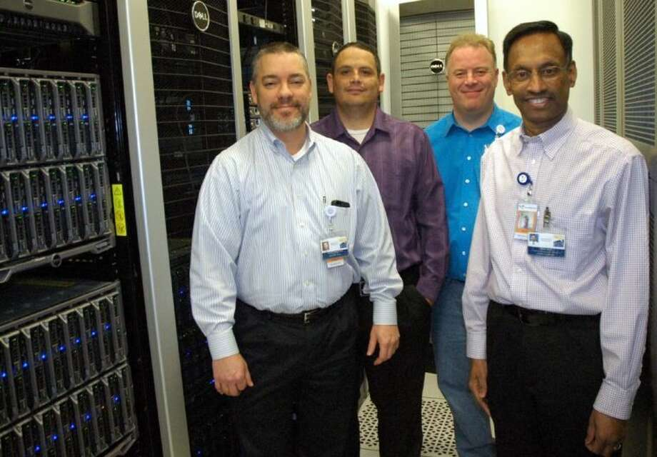 Wes Hargrove (left), Danny Cain, Paul Clarbull and Venu Rao inside the district's secure, off-site server space. Photo: Rusty Graham