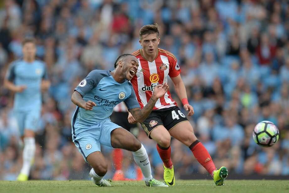 Sunderland's US midfielder Lynden Gooch (R) challenges Manchester City's English midfielder Raheem Sterling (L) during the English Premier League football match between Manchester City and Sunderland at the Etihad Stadium in Manchester, north west England, on August 13, 2016. / AFP PHOTO / OLI SCARFF / RESTRICTED TO EDITORIAL USE. No use with unauthorized audio, video, data, fixture lists, club/league logos or 'live' services. Online in-match use limited to 75 images, no video emulation. No use in betting, games or single club/league/player publications.  / OLI SCARFF/AFP/Getty Images Photo: OLI SCARFF, AFP/Getty Images