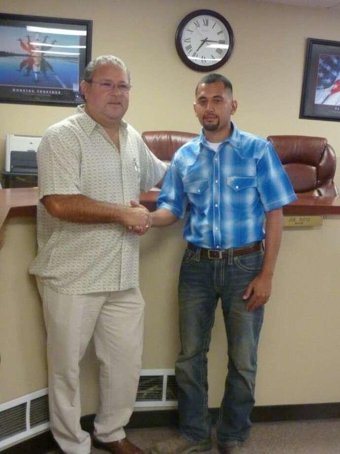 South Houston Mayor Joe Soto congratulates newly-elected Mayor Pro Tem Willie Rios. Photo: KRISTI NIX