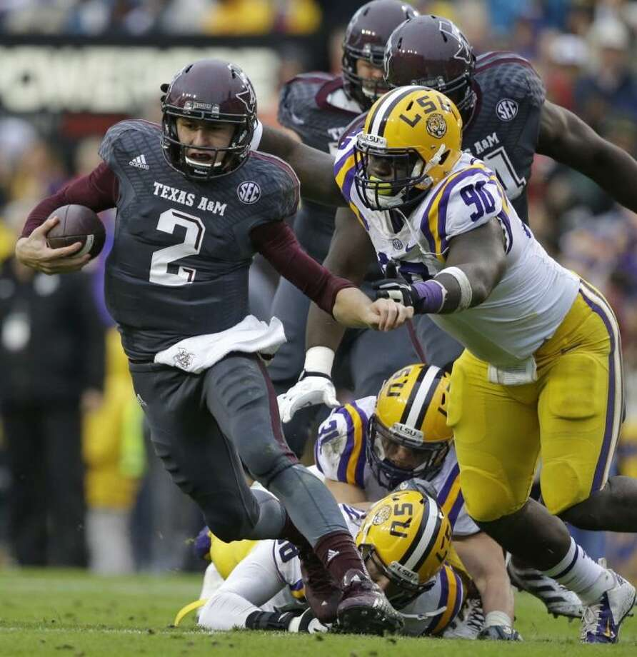 Texas A&M quarterback Johnny Manziel scrambles against LSU during the first half of a game on Nov. 23 in Baton Rouge, La. The Tigers won, 34-10.