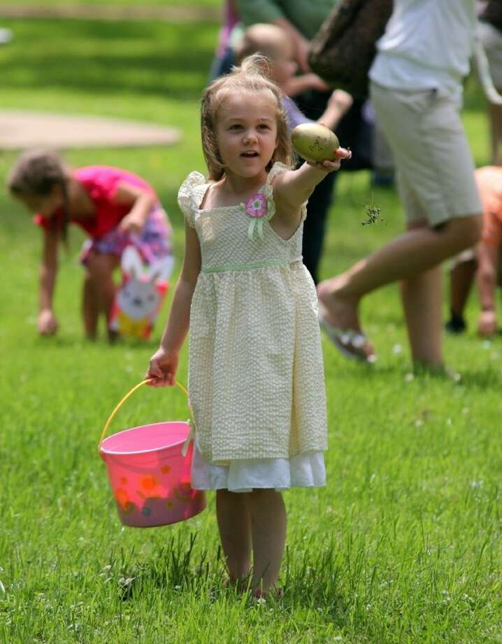"Makena 4, holds up the prized ""gold"" egg in the 4-6 year old group. The prizes were Easter baskets provided from HEB. Photo: Kar B Hlava"