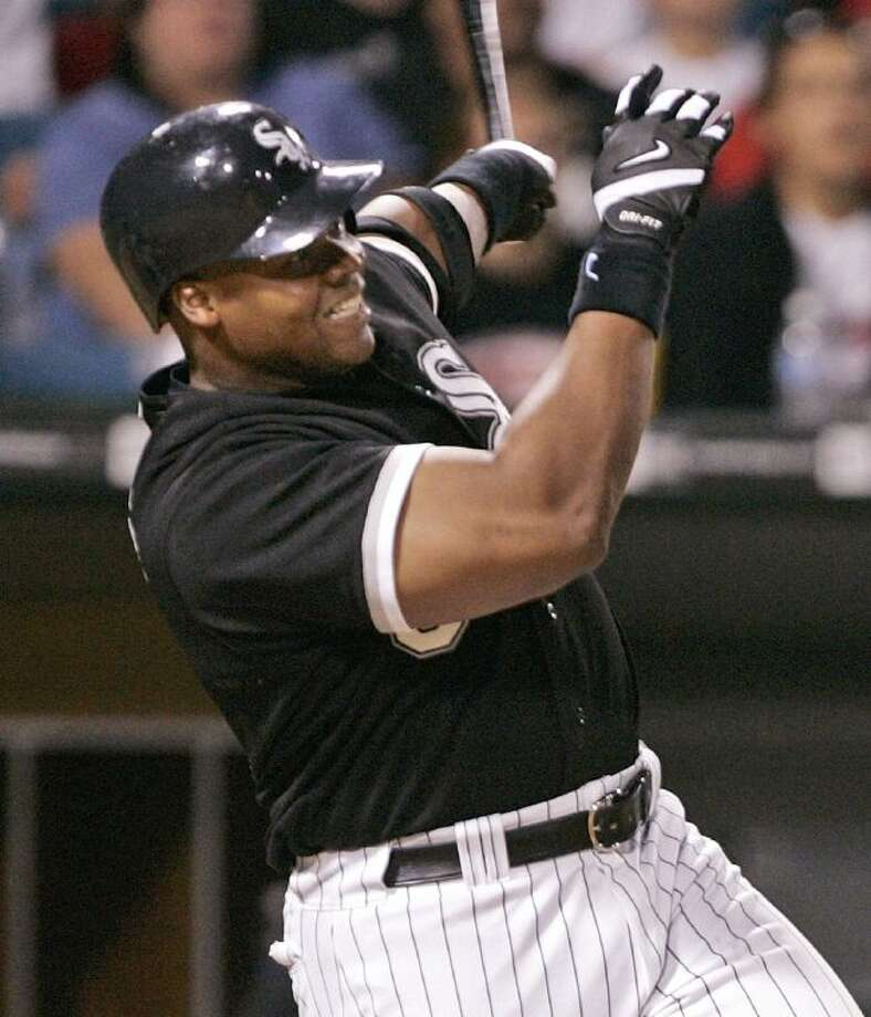 The Chicago White Sox's Frank Thomas hits a three-run home run during the eighth inning against the Tampa Bay Devil Rays on July 5, 2005, in Chicago.