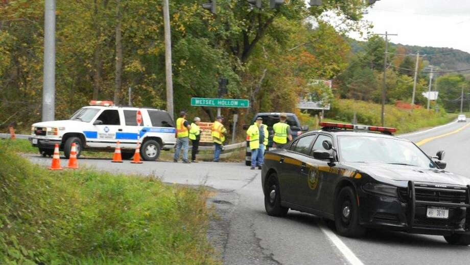 Schoharie County officials search for a county resident who allegedly stole a State Police car and later abandoned it on Wetsel Hollow Road in the Town of Schoharie on Sunday, Oct. 2, 2016. (Martin Miller / Special to the Times Union)