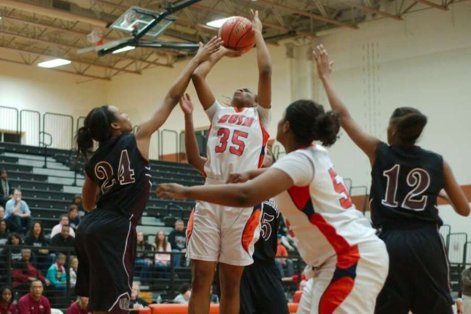 Faith Ohanta (35) and Cierra Palmer (52) helped Bush defeat Austin 44-42 for sole possession of the District 23-5A lead. Photo: Kirk Sides/HCN