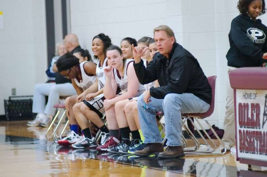 Pearland head football coach Tony Heath signals to one of his players during the Lady Oilers' freshman basketball game against Alvin Friday. Heath won his debut as the team's coach, 34-23. Photo: KIRK SIDES