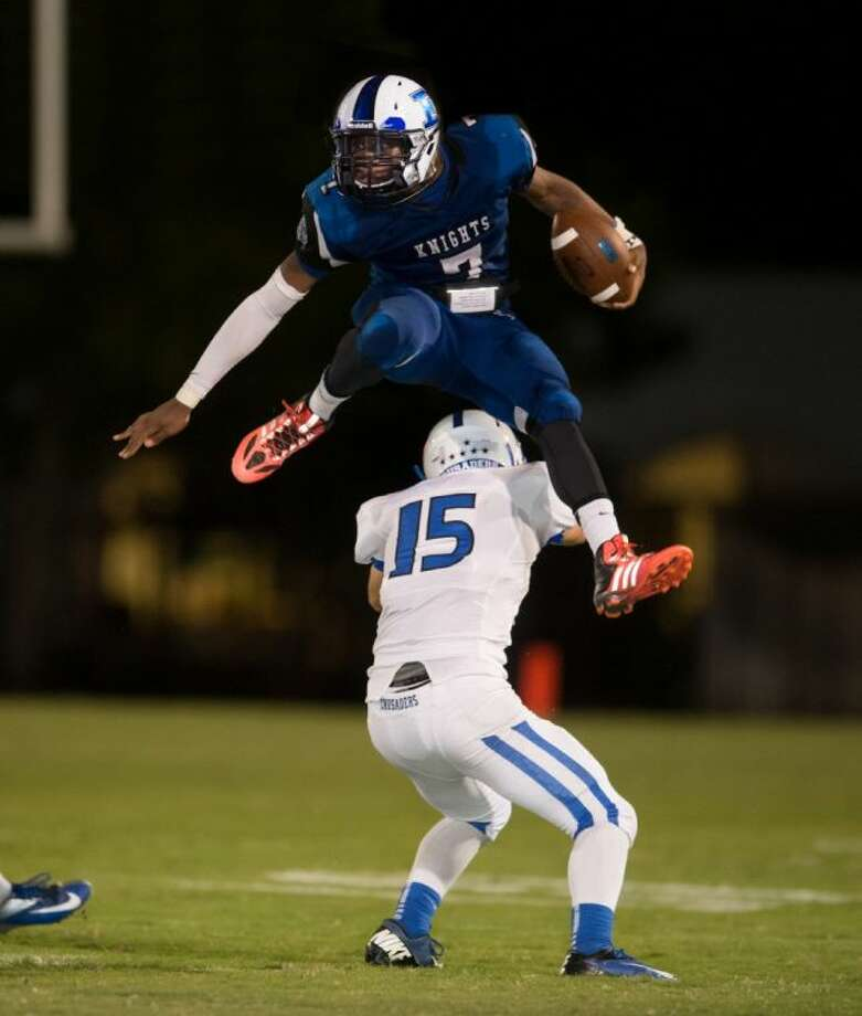 Episcopal junior running back Tyreik Gray, shown here leaping over an opponent during the season, was named to the Southwest Preparatory Conference all-conference first team at his position.