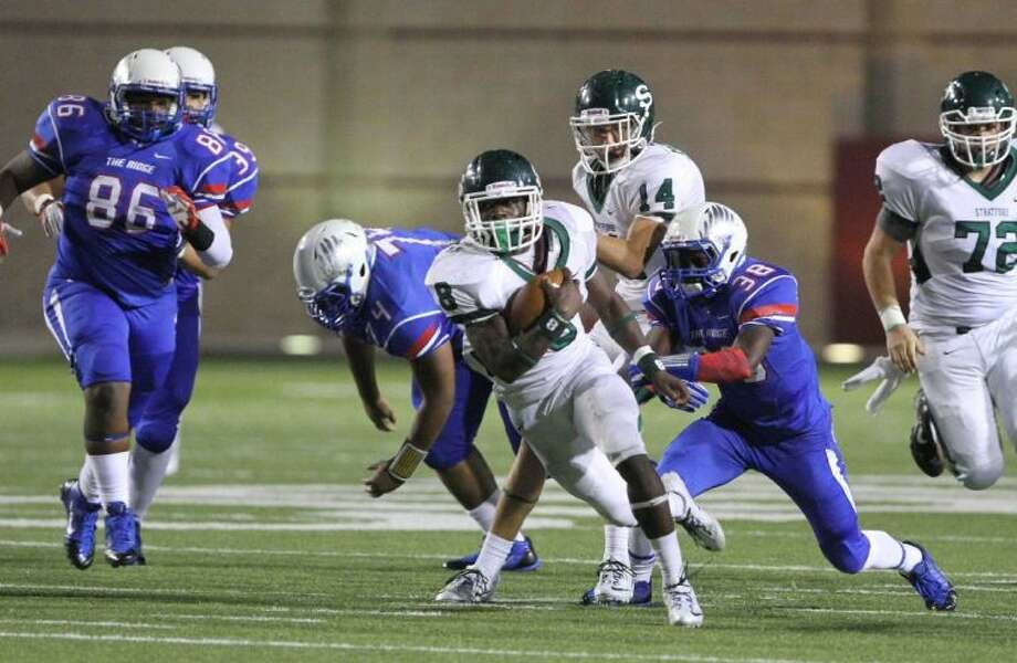 Stratford running back Terrance Peters, shown here leaving Oak Ridge defenders in his wake, has been named the Offensive Most Valuable Player in District 22-4A. Peters is a three-year starter for the Spartans and was one of the city's top rushers in helping the Spartans get to the Class 4A, Division I state semifinals. The Spartans were 12-3 on the season and advanced all the way to within one game of playing for the 4A state title before they fell to San Antonio Brennan.