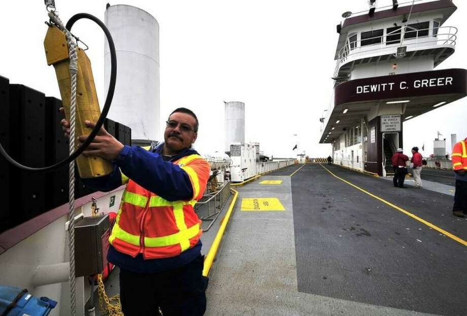 José Tamayo takes care of operations on the deck of the Galveston Island Ferry. Photo credit: Jeannie Peng-Armao, San Jacinto College marketing, public relations, and government affairs department.