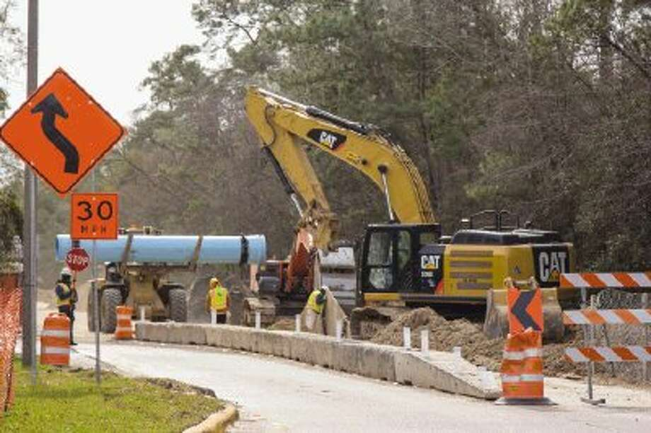 Construction crews work on a water pipeline near the intersections of North Millbend Drive and Grogan's Mill Road Monday in The Woodlands. Neighboring businesses have been affected by the construction. Photo: Staff Photo By Ana Ramirez / The Woodlands Villager
