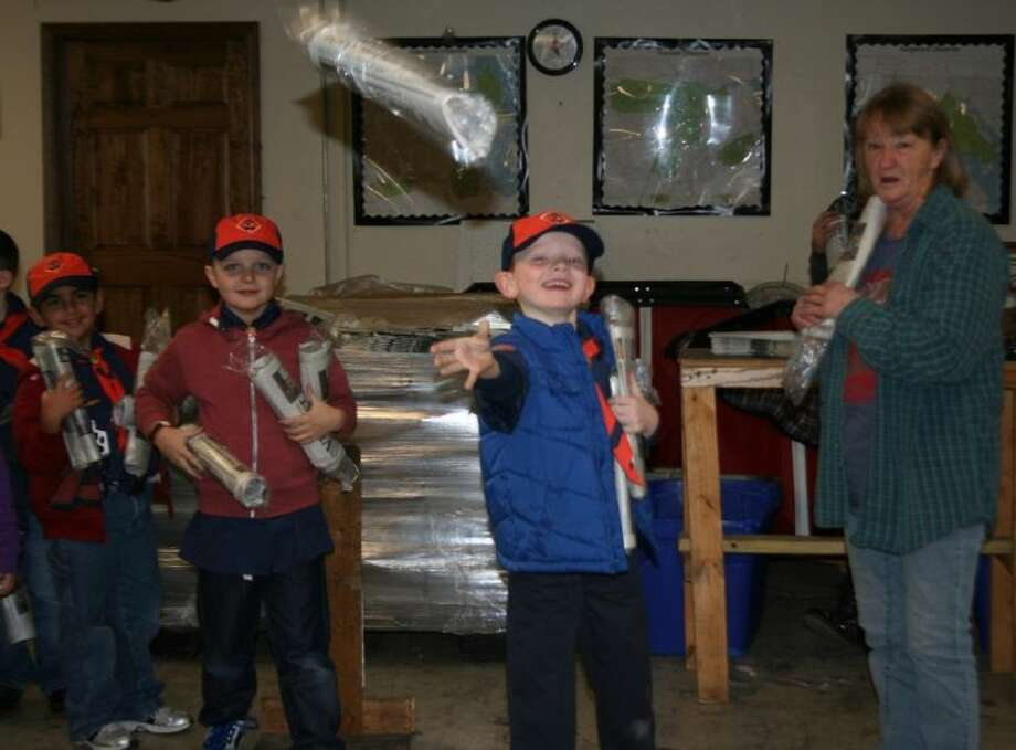 Hayden Hallmark practices throwing a newspaper during the Cub Scout Pack 912 Go See It visit to the Observer Newspapers office in Humble Jan. 7. Photo: MELECIO FRANCO