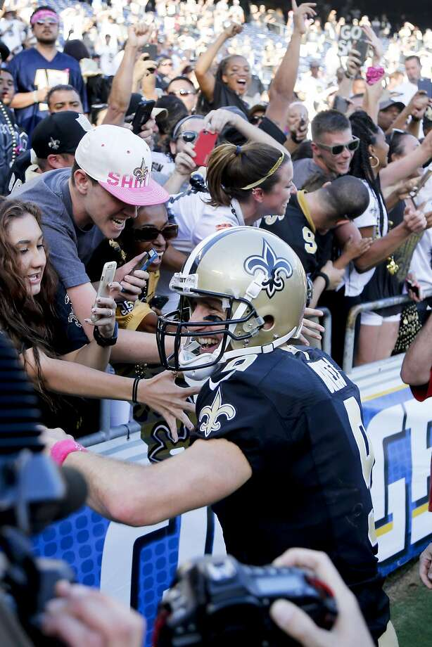 Saints quarterback Drew Brees celebrates with fans. Photo: Lenny Ignelzi, Associated Press