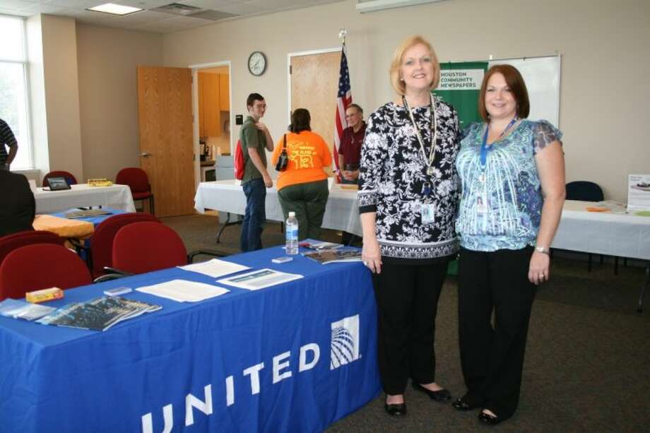 Representatives Cheryl Austin and Erica Huddleston of United Airlines met several qualified candidates for employment at the job fair held at RB Tullis Branch Library on July 25. Photo: STEPHANIE BUCKNER