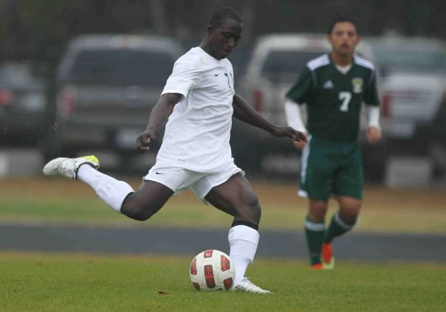 The Woodlands midfielder Bubacarr Jobe takes a shot on goal during a match against Stratford in the Kilt Cup on Thursday at The Woodlands High School. To view or purchase this photo and others like it, visit HCNpics.com.