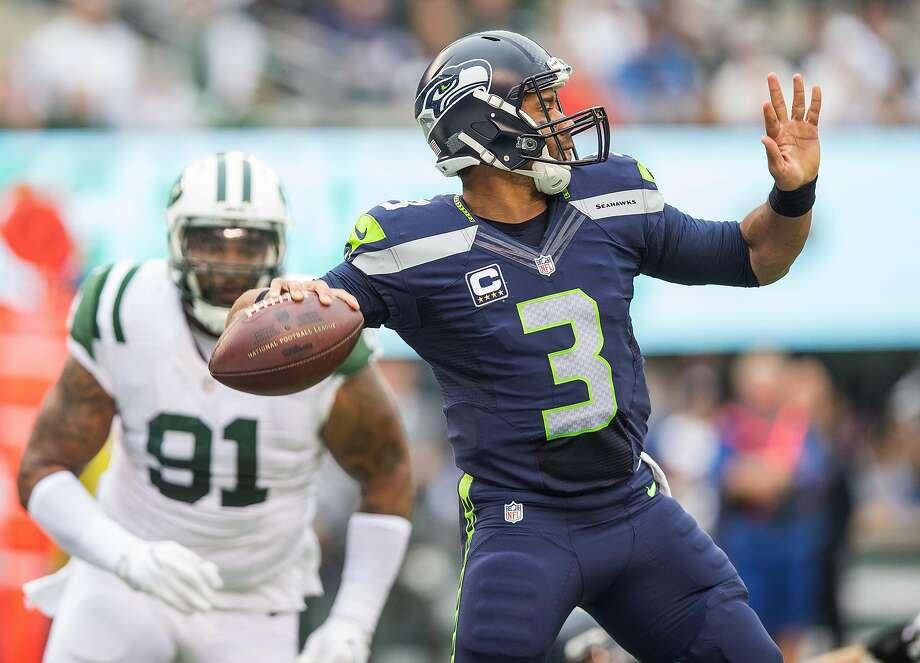 Seahawks quarterback Russell Wilson unloads before Jets defensive lineman Sheldon Richardson can reach him. Photo: Dean Rutz, TNS