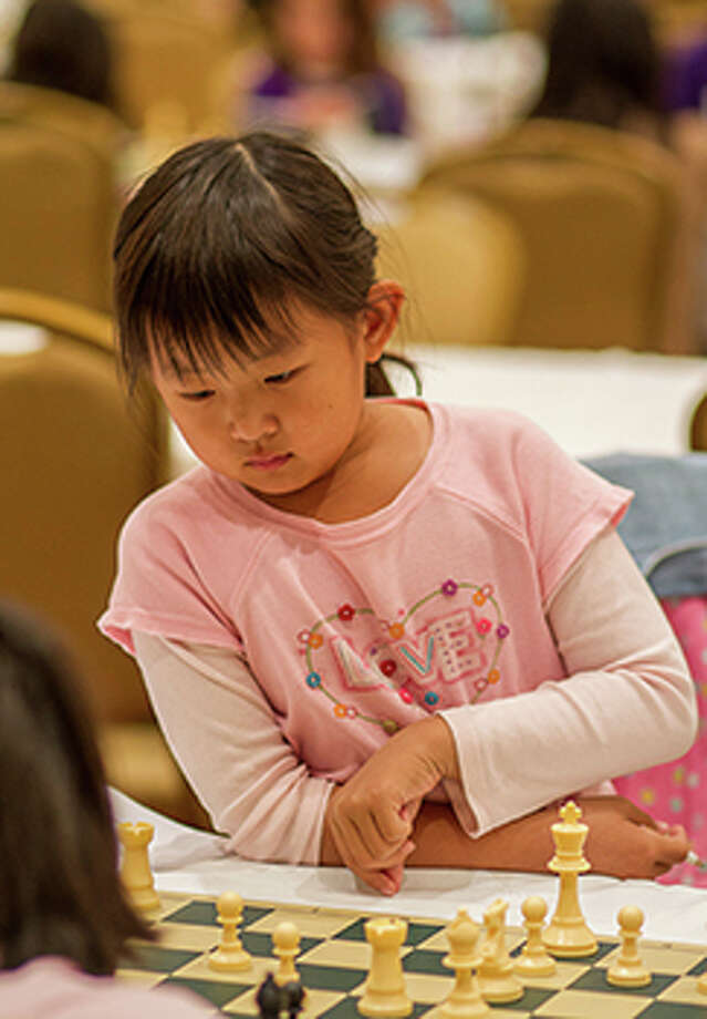 Hamilton Elementary School third-grade student Maggie Ni placed fourth in the Under 8 Girls group at the World Junior Chess Championship, held Dec. 17-29 in the United Arab Emirates. Photo: Jorge Barrera