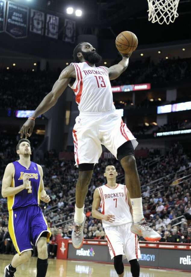 Houston's James Harden goes up for a dunk as the Los Angeles Lakers' Ryan Kelly and the Rockets' Jeremy Lin look on in the second half of Wednesday's game in Houston. Harden scored 38 points in the Rockets' 113-99 win.