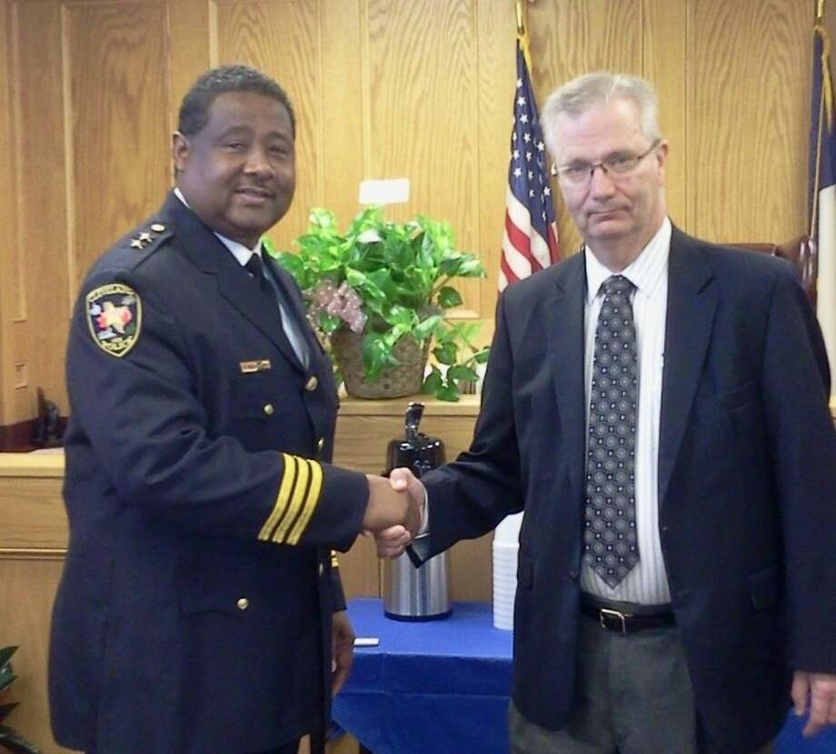 Darrel Broussard (left) is congratulated by Cleveland City Manager Dion Miller after Broussard was sworn in on Monday, Oct. 1, as the city's new police chief. Photo: DIANNE BRADY