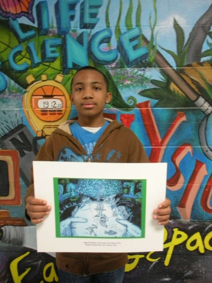Seventh-grade Olympia Middle School student Samuel Melvin poses with his winning drawing from the Houston Earth Day Art Competition. Students in grades three through eight across the Houston area competed against students in their grade level in the contest; the winner was chosen by a public vote on the contest's website.