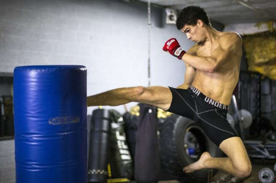 Mixed Martial Arts fighter Charlie Ontiveros works on his technique on Jan. 11 at the Tiger Warriors School of Martial Arts in Cleveland. Photo: ANDREW BUCKLEY