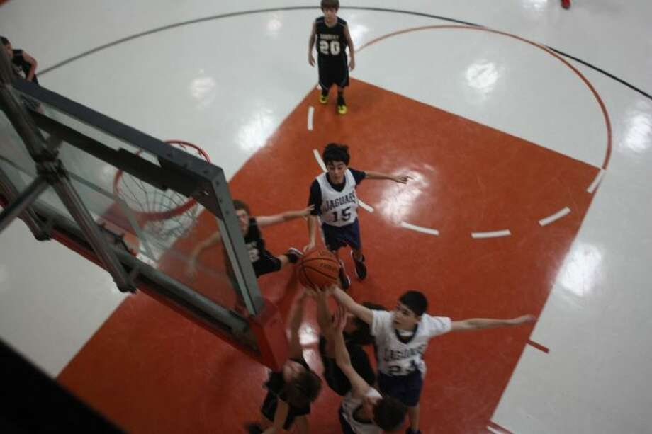 A unique view taken from the second floor of Faith Christian Academy's gymnasium, two of the 12 teams in the tournament battle under the boards Friday morning. Photo: Robert Avery