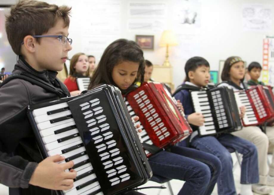 Carleston Elementary students try their hand at the accordion in Brian Berlin's music class. Photo: Courtesy Pearland ISD