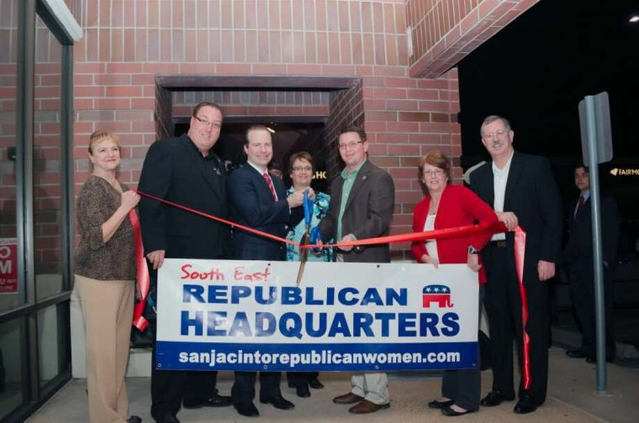 Left to right Barbara Legler, Keith Nielsen, Jared Woodfill, Tammie Nielsen, Joanne Cade and Mike Cade stand as Harris County Commissioner Jack Morman cuts the ribbon to officially open Candidates, supporters and volunteer fill the South East Republican Party headquarters as the office is officially opened Wednesday, Jan. 8.