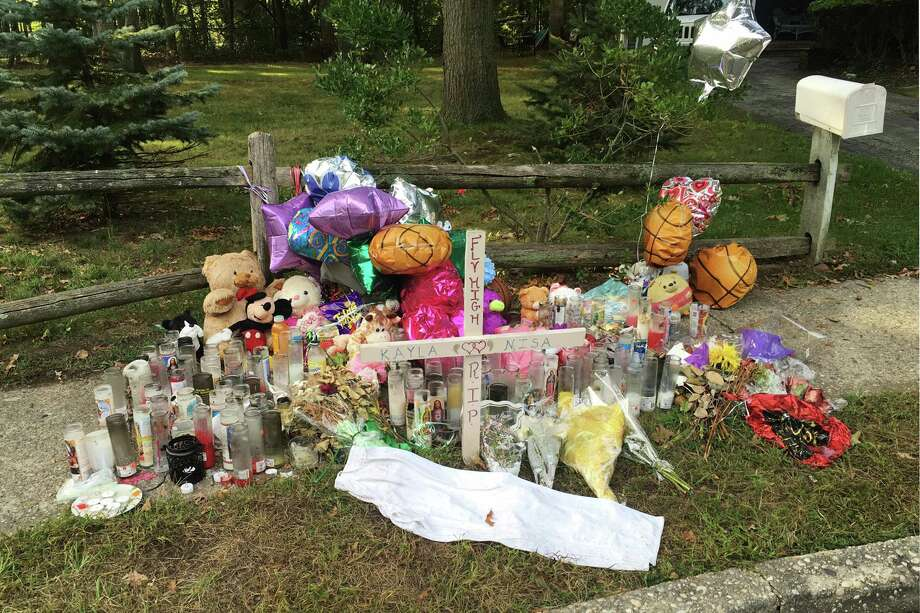 In this Sept. 27, 2016 photo, a memorial for Nisa Mickens and Kayla Cueva is located near the locations where their bodies were found in Brentwood, N.Y. The girls, who were best friends, were found murdered. Multiple teenagers from the same Long Island high school have been found dead and while police suspect all the deaths are related to gang violence, they are releasing few details. (AP Photo/Claudia Torrens) ORG XMIT: RPCT103 Photo: Claudia Torrens / Copyright 2016 The Associated Press. All rights reserved.