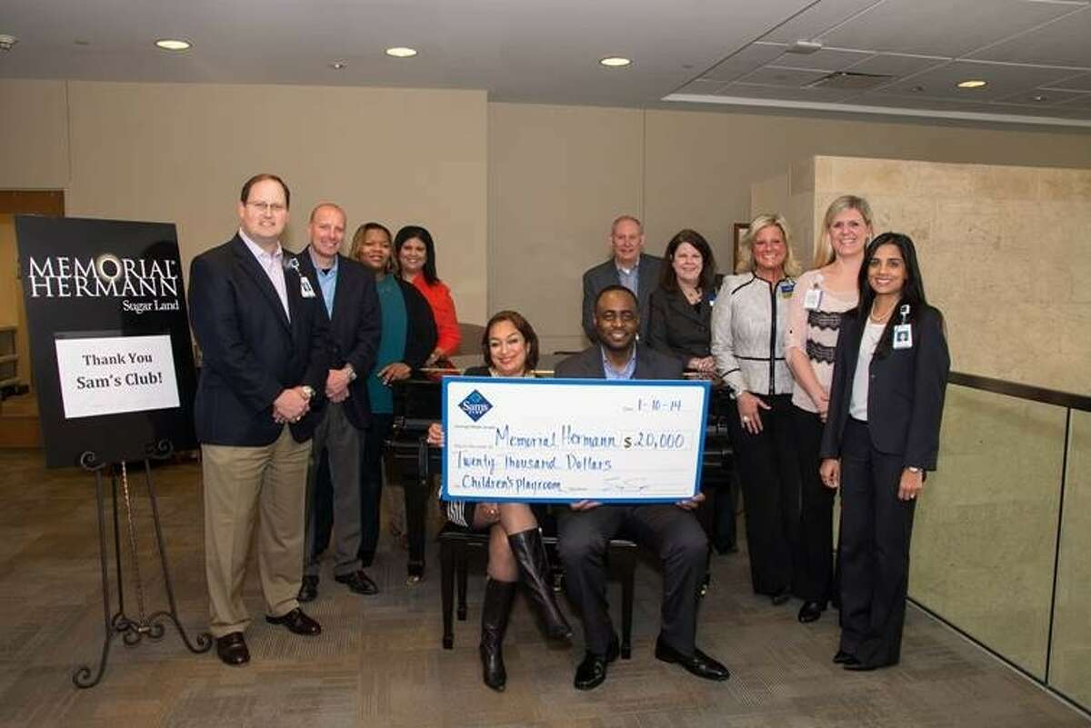Representatives from Sam's Club present Memorial Hermann Sugar Land with a 20,000 check for it's children's play areas on Friday, Jan. 10.