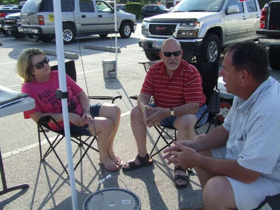 Position 2 Councilman Mark Stoll talks with friends Pam and Chuck Puccio as he tables during the general election on May 12.
