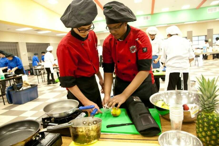 Porter High school Students Stormy Brumfield, right, and Brandon Divins, left, team up in the 2013 Porter Chopped Competition held at the Annex building. Photo: Amanda J.Cain/ The Observer